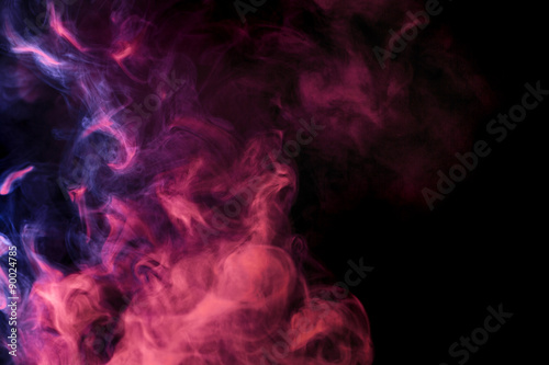 Abstract colored smoke hookah on a black background.
