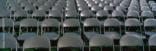 Photo These are empty, grey folding chairs awaiting the crowd to attend the U