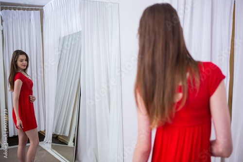 Fotografie, Obraz  Woman trying on a red dress
