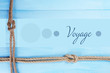 Voyage concept. Marine knots on wooden background