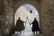 Medieval Warriors Guarding Door