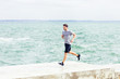 Man running on the pier at beach
