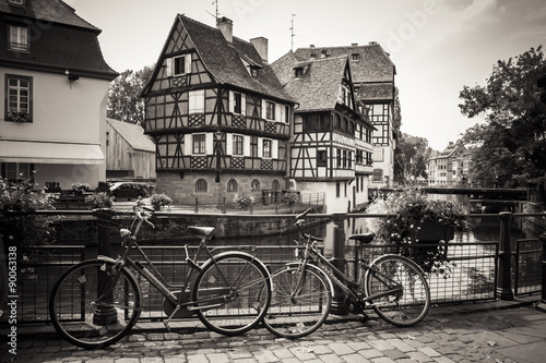 Bicycles in front of the River and Houses in Strasbourg, sepia edit #90063138