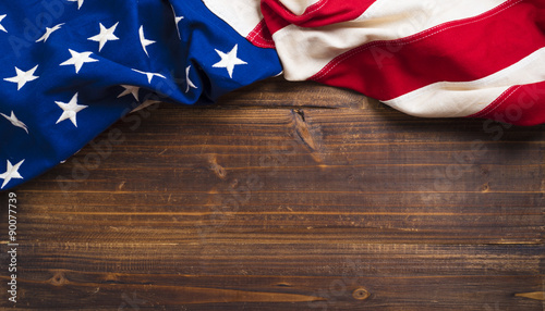 Fototapeta Old American Flag on wooden plank background