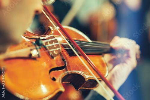 Fotografie, Obraz Symphony orchestra on stage, hands playing violin