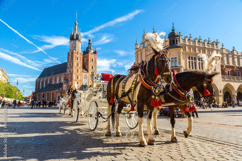 Fototapeta Horse carriages at main square in Krakow