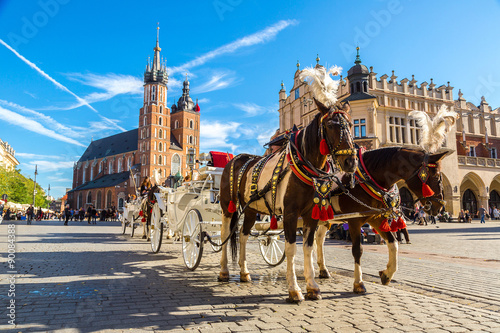 Fotobehang Krakau Horse carriages at main square in Krakow