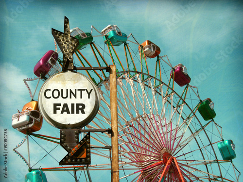Photo  aged and worn vintage photo of county fair sign with ferris wheel