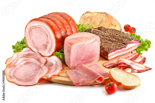 Cutting board with pork, bacon, ham and bread