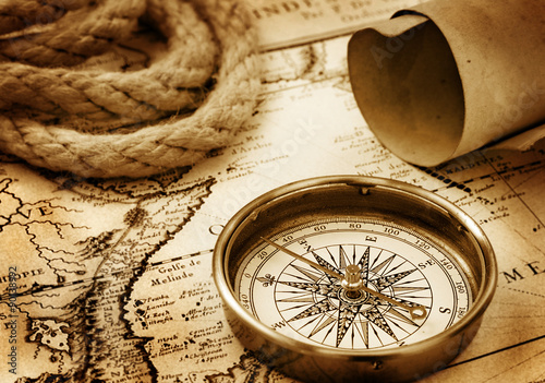 Papiers peints Retro Vintage compass, rope and paper sroll on map