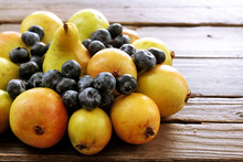 Ripe Pears And Blueberries On Wooden Table Close Up
