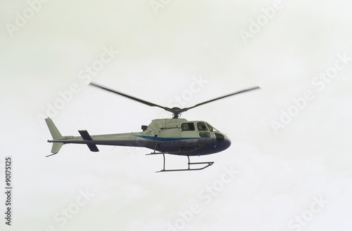 Tuinposter Helicopter light civil helicopter flies in the sky and carries tourists