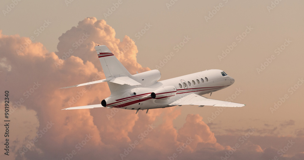Fototapety, obrazy: Private jet flying through clouds
