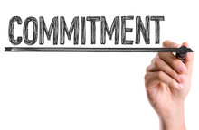 Hand With Marker Writing The Word Commitment