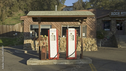 Antique red gas pumps in front of old gas station in Malibu