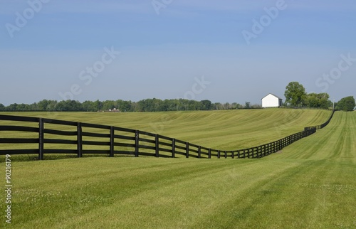 Láminas  Dark colored fence bordering a rural property in the countryside