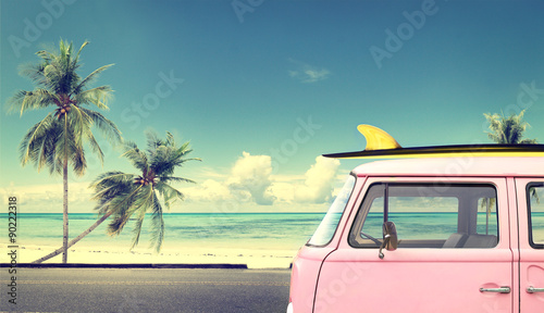 Photo  Vintage car in the beach with a surfboard on the roof