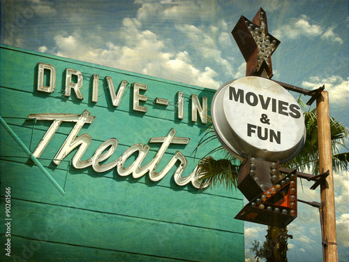 Fotografie, Obraz  aged and worn vintage photo of drive in movies sign