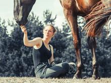 Young Woman Girl Feeding Horse.