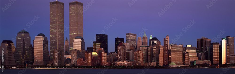 Fototapeta Panoramic view of lower Manhattan and New York City skyline, NY with World Trade Towers at sunset