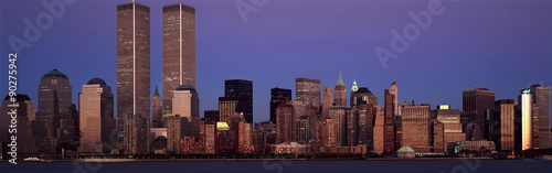 Panoramic view of lower Manhattan and New York City skyline, NY with World Trade Towers at sunset