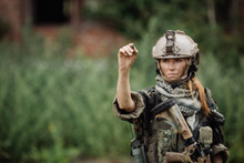 Woman Soldier Writes Marker On Transparent Glass