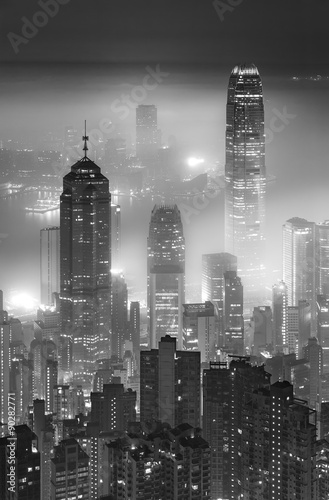 Misty night view of Victoria harbor in Hong Kong city Poster