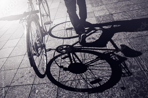 Fotobehang Fiets Man Pushing Bicycle, Street Shadow