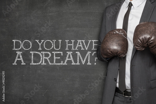 Photo  Do you have a dream on blackboard with businessman on side