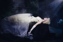 Sleeping Beauty. Beautiful Lifeless Bride In White Dress Lying O