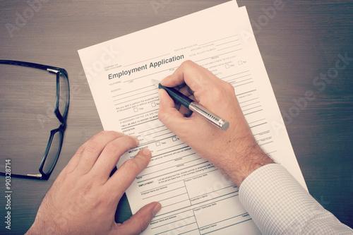 Fotografie, Obraz  Man fillling a job application form