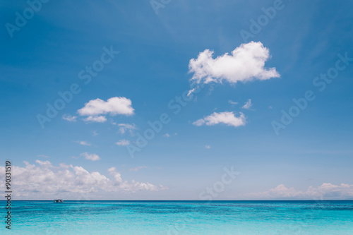 Foto auf Gartenposter Strand blue sky with sea and beach - soft focus with film filter