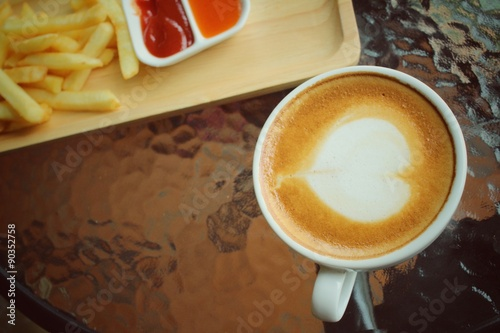 Latte art coffee with french fries