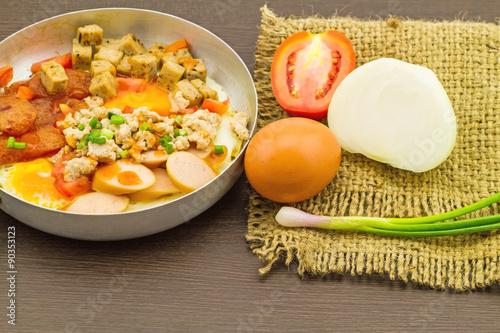 Foto  Indochina pan-fried egg with garnish on sack fabric