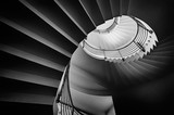 Black and white photograph of spiraling staircase shot from low angle. - 90363568