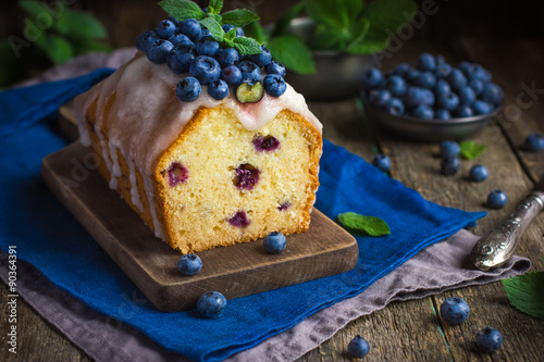 blueberry cake with sugar icing and fresh berries Poster
