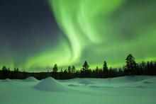 Aurora Borealis Over Snowy Win...