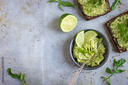 Fotografie, Obraz  guacamole and rye toasts on rustic  background