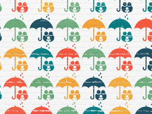 Insurance Concept: Umbrella Icons On Wall Background