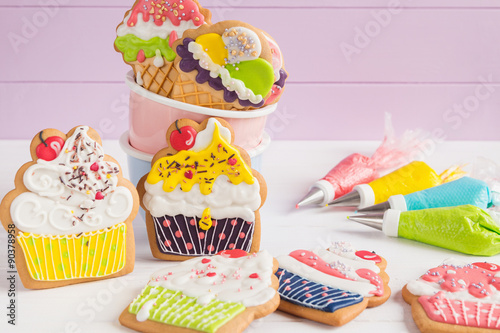 Tuinposter Koekjes Colorful icing cookies in cupcake shape