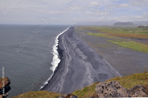 Dyrhólaey peninsula in south Iceland, coastline with black sand