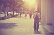 People walking in the street. Vintage photo