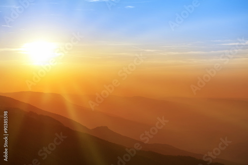 Foto op Canvas Ochtendgloren Beautiful sunset in the mountains