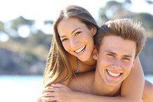 Couple With Perfect Smile Posing On The Beach