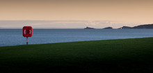 Swansea Bay With A Life Saver And View Of The Mumbles