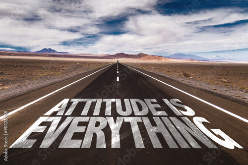 Photo Attitude is Everything written on desert road