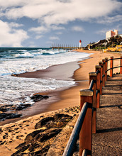 View Of Umhlanga Rocks Lighthouse, Milennium Pier And Beach From The Promenade