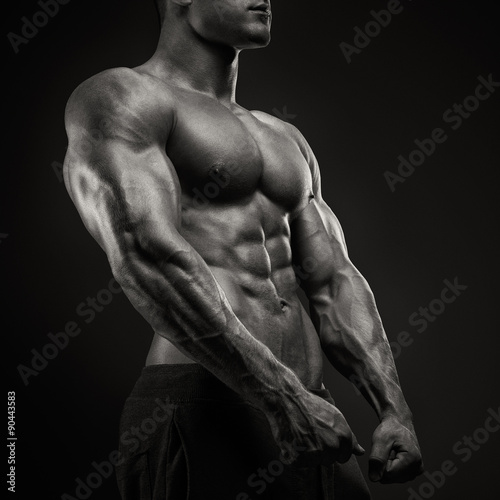 Strong and power bodybuilder posing Canvas Print