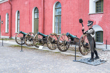 Old Artillery Cannons With Wax Statue Of Soldier In Form Of 19th Century In Naryshkin Bastion Of Peter And Paul Fortress, St.Petersburg, Russia.