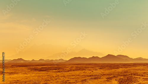 Poster Secheresse Sunrise in a stone desert - mountain landscape in Africa.